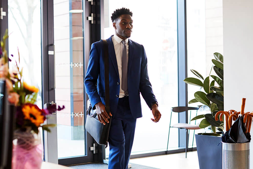 Man in suit walking into building