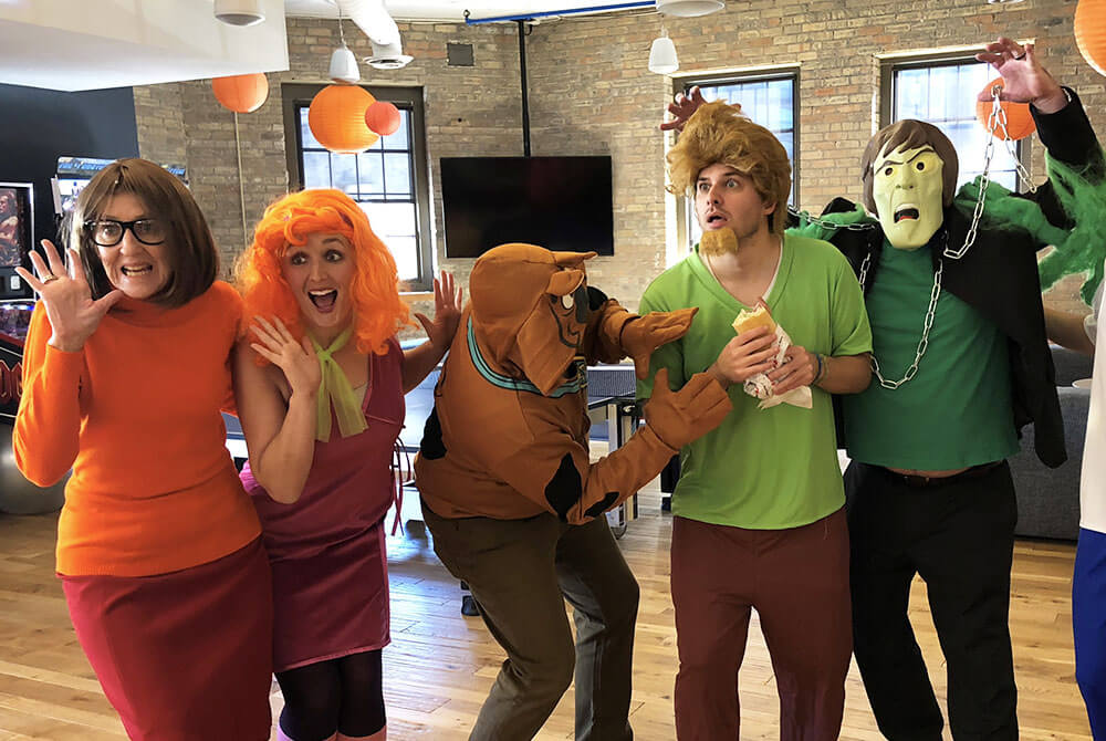Group of people dressed as Scooby Doo characters for Halloween