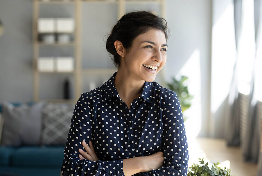 Woman in a polka dot shirt smiling