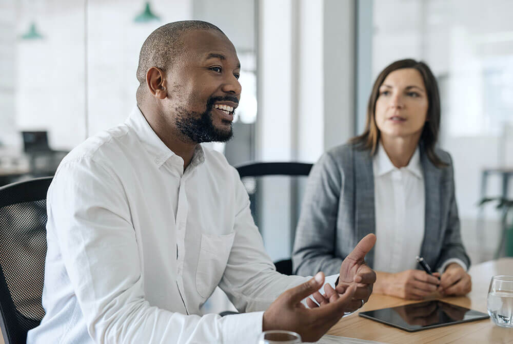 Image of man talking during a meeting